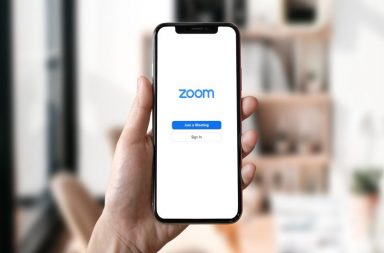 Hand holding Phone with Zoom error