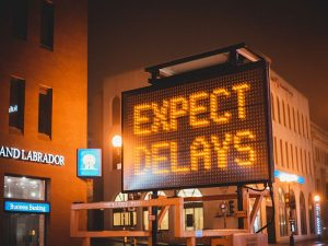 sign showing expect delays text